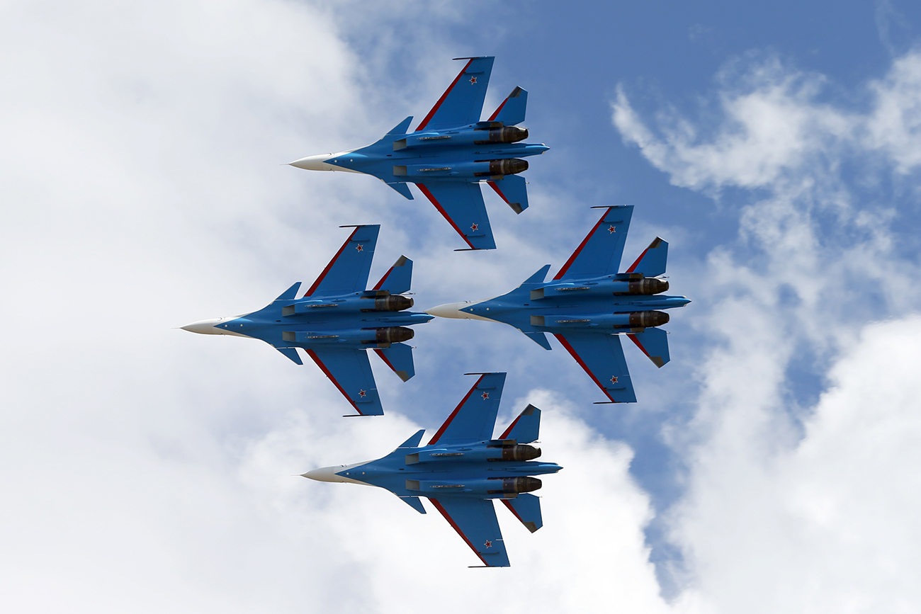 LANGKAWI, MALAYSIA -- MARCH 21, 2017: Sukhoi Su-30SM fighter aircraft of the Russkiye Vityazi (Russian Knights) aerobatic team perform at the 2017 Langkawi International Maritime and Aerospace Exhibition (LIMA'17).