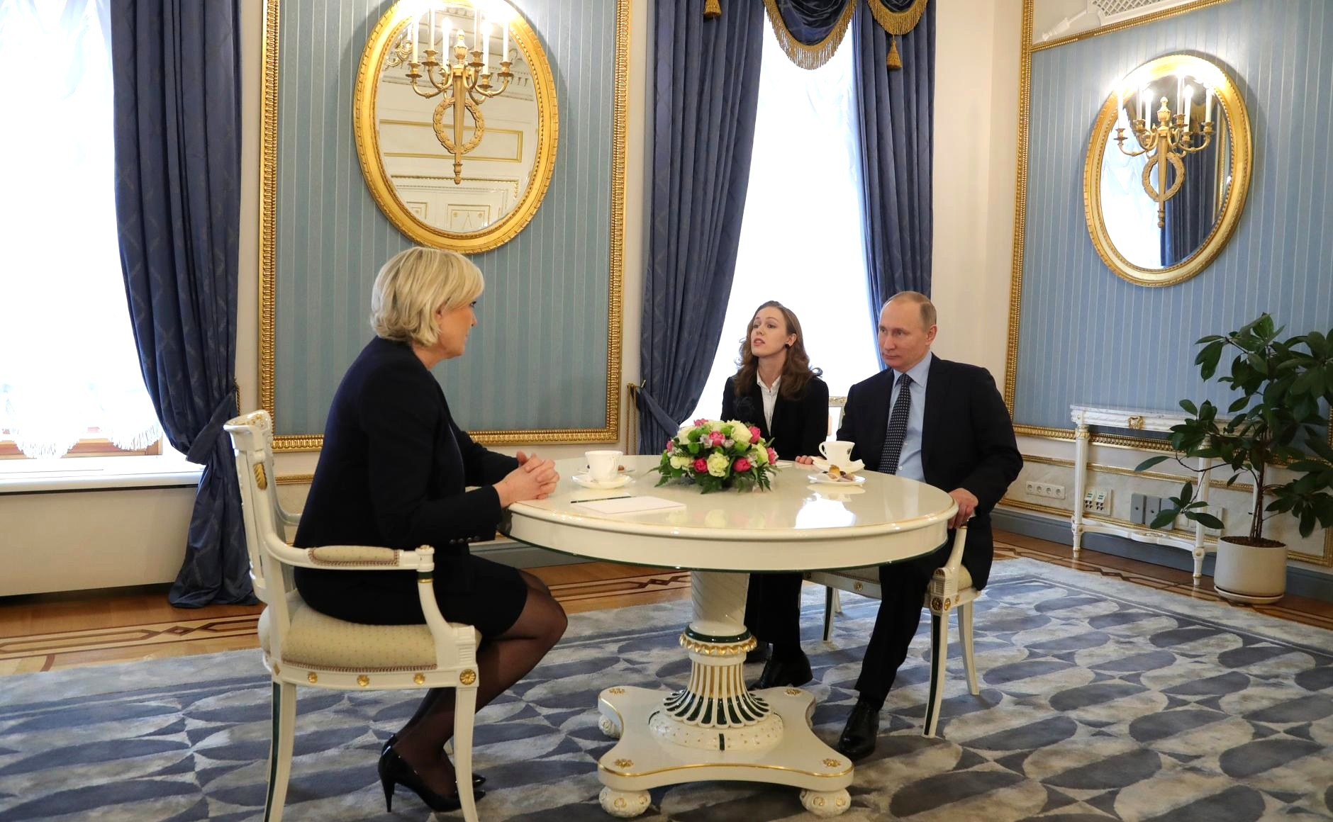 Vladimir Putin meets with Marine Le Pen in the Kremlin.