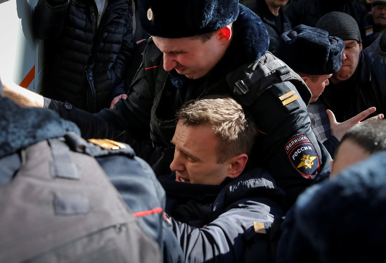 Police officers detain anti-corruption campaigner and opposition figure Alexei Navalny during a rally in Moscow, March 26, 2017.