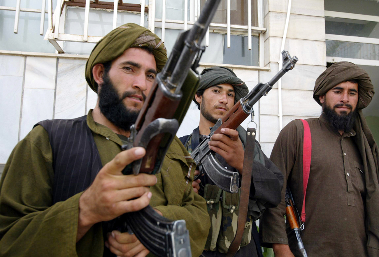 Taliban militants pose for the media after they join the Afghan government in Herat, May 22, 2010.