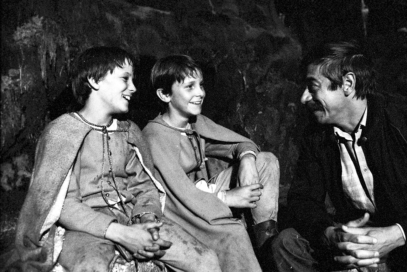 "Director Vladimir Grammatikov talking to young artists British schoolchildren Nick Pickard and Christian Bale before filming the feature film ""Mio, my Mio."""