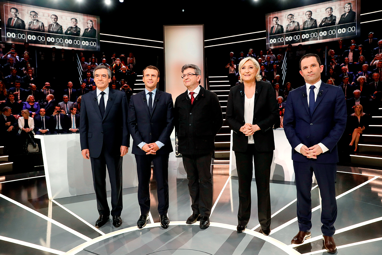 French presidential election candidates (LtoR) Francois Fillon, Emmanuel Macron, Jean-Luc Melenchon, Marine Le Pen and Benoit Hamon, pose before a debate organised by French private TV channel TF1 in Aubervilliers, outside Paris, France, March 20, 2017