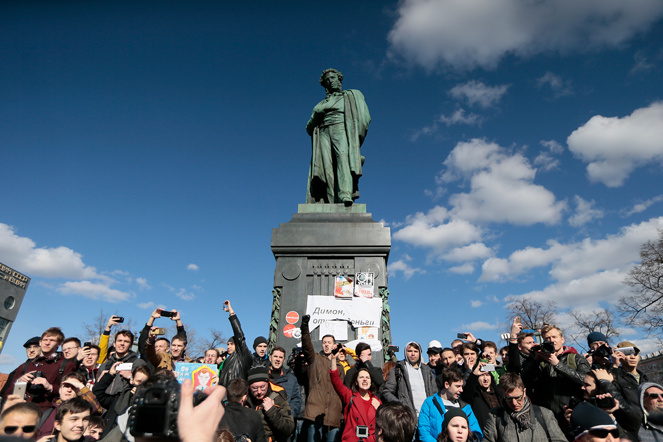 People surround Alexander Pushkin monument. On March 26, protests against corruption were held across Russia.