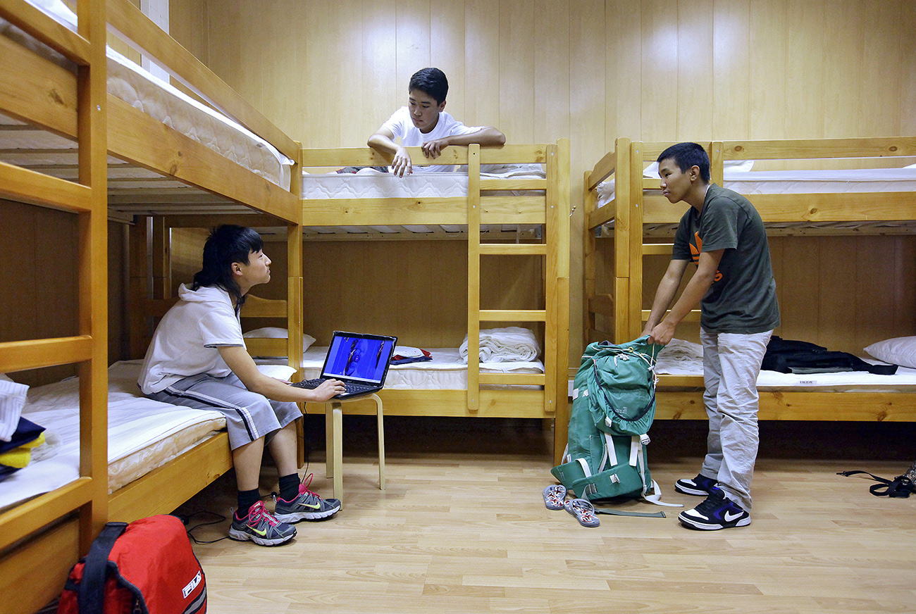 Lodgers at 'Novy Arbat' hostel in their room.