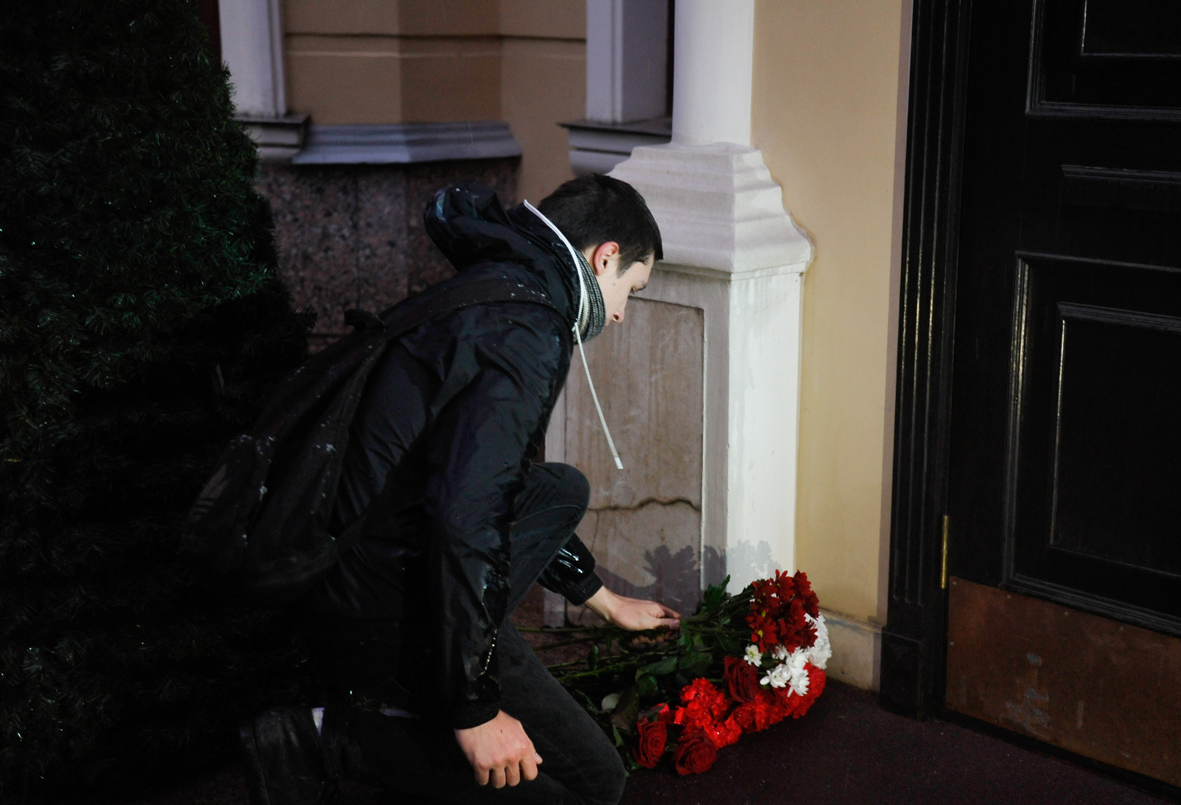 People are bringing flowers and candles to the St. Petersburg government's office in Moscow to commemorate those who died in the metro blast.