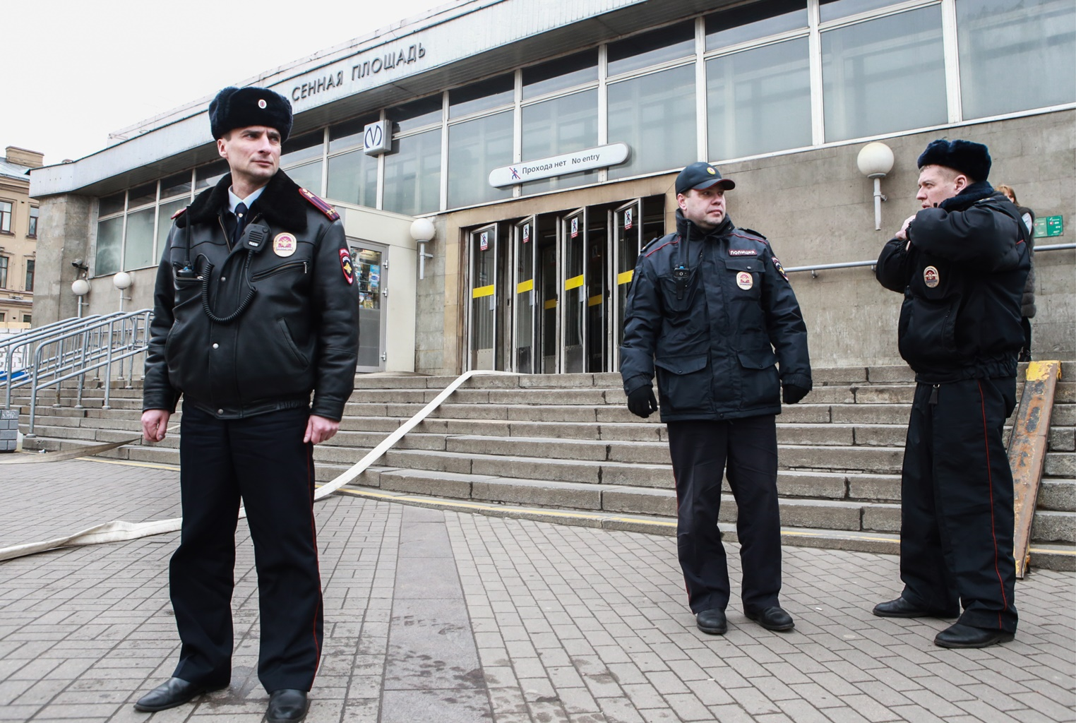 Police officers near Sennaya Ploshchad station of the St Petersburg metro in the aftermath of an explosion which occurred in a train at 2:40 p.m. Moscow time.