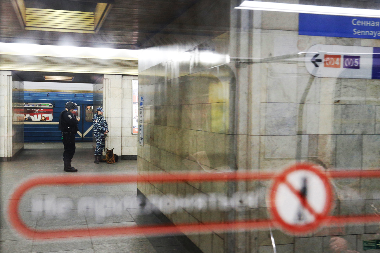 Police officers are seen through the window of a train at Sennaya Ploshchad metro station which was closed over an anonymous call of a bomb threat after the deadly blast in the underground, in St. Petersburg, April 4, 2017.