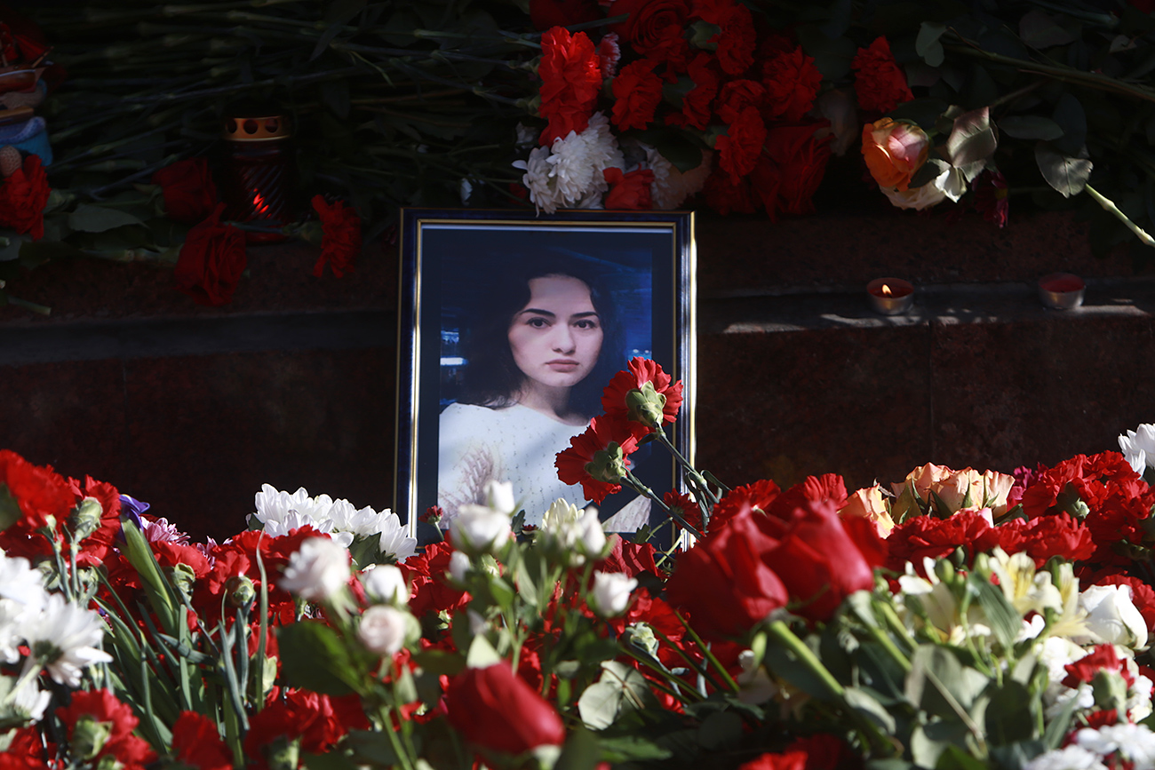 Flowers and a portrait of a victim of the St Petersburg Metro explosion Dilbara Alieva.