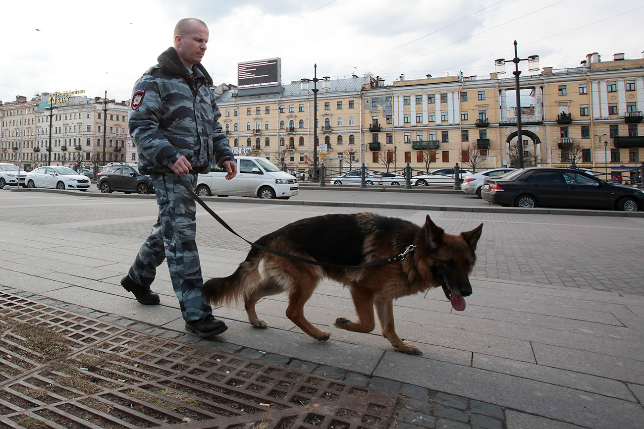 A law enforcement officer with a dog in St. Petersburg as security tightens in the wake of a terrorist attack.