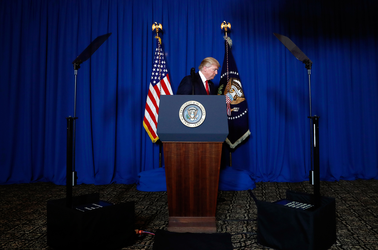 President Donald Trump walks from the podium after speaking at Mar-a-Lago in Palm Beach, Fla., April 6, 2017, after the U.S. fired a barrage of cruise missiles into Syria.