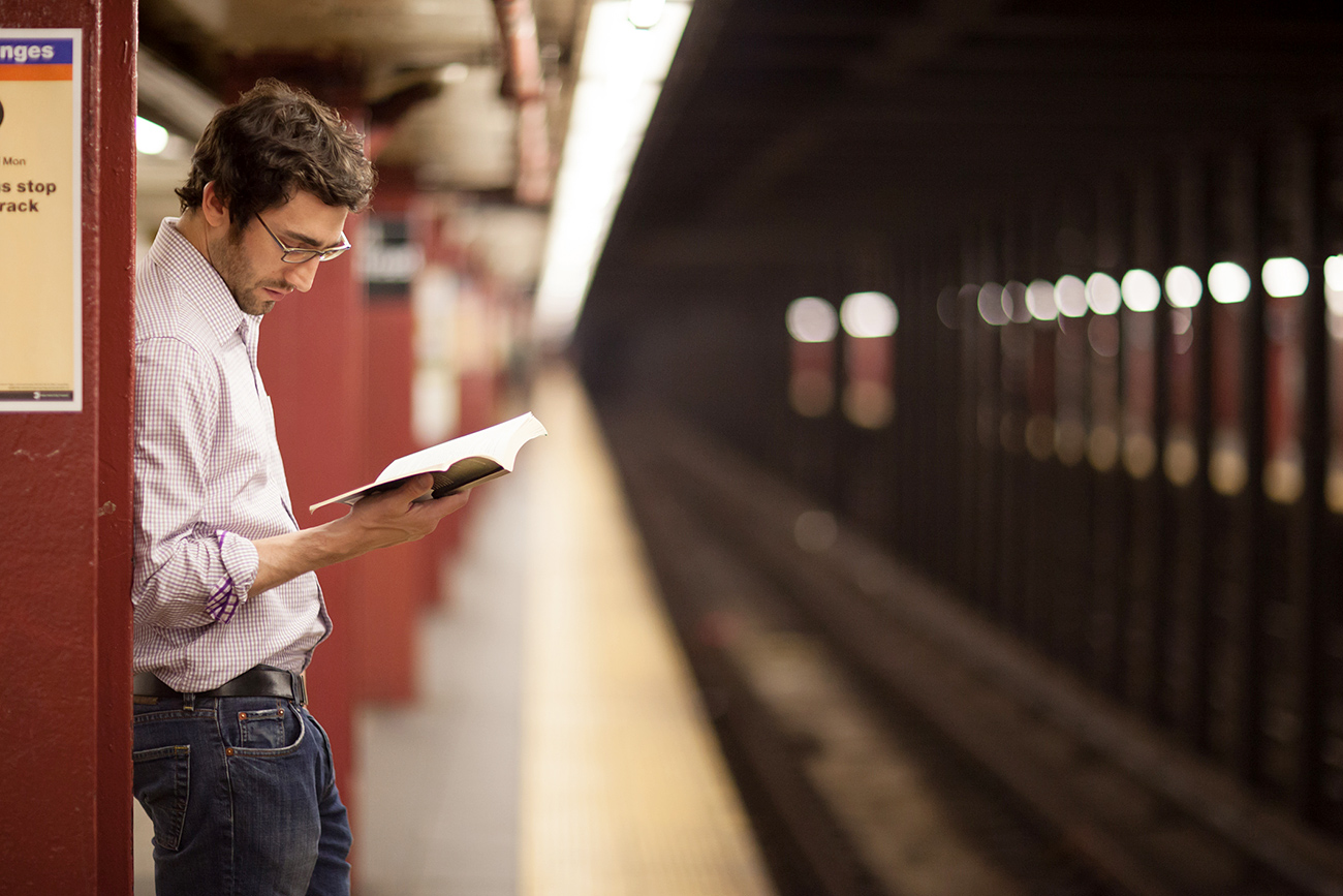 Russians' view of American literature still needs to be improved. A man waits for a subway train in New York City.