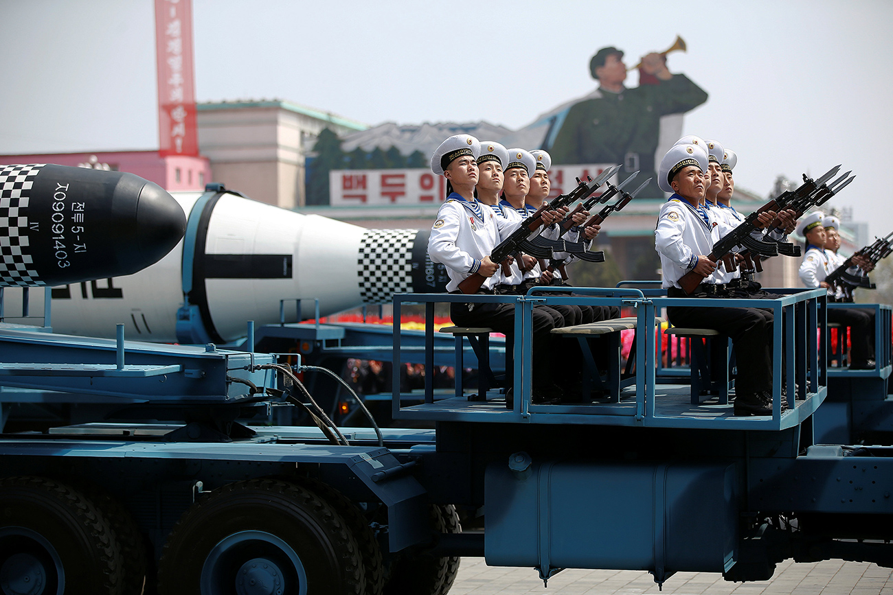 "Military vehicles carry missiles with characters reading ""Pukkuksong"" during a military parade marking the 105th birth anniversary of country's founding father Kim Il Sung, in Pyongyang April 15, 2017."