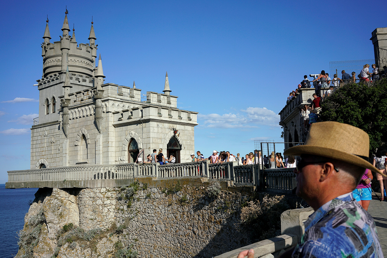 Tourists visit the Swallow's Nest castle near the Black Sea resort of Yalta, Crimea.