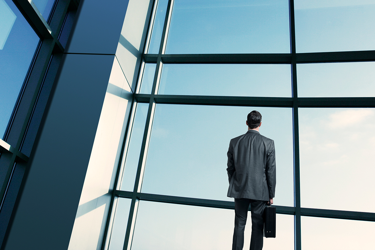 Businessman staring out window