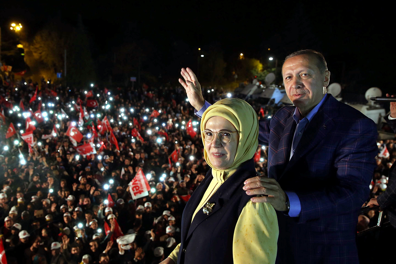 Turkish President Tayyip Erdogan, accompanied by his wife Emine Erdogan, addresses his supporters in Istanbul, Turkey, late April 16, 2017