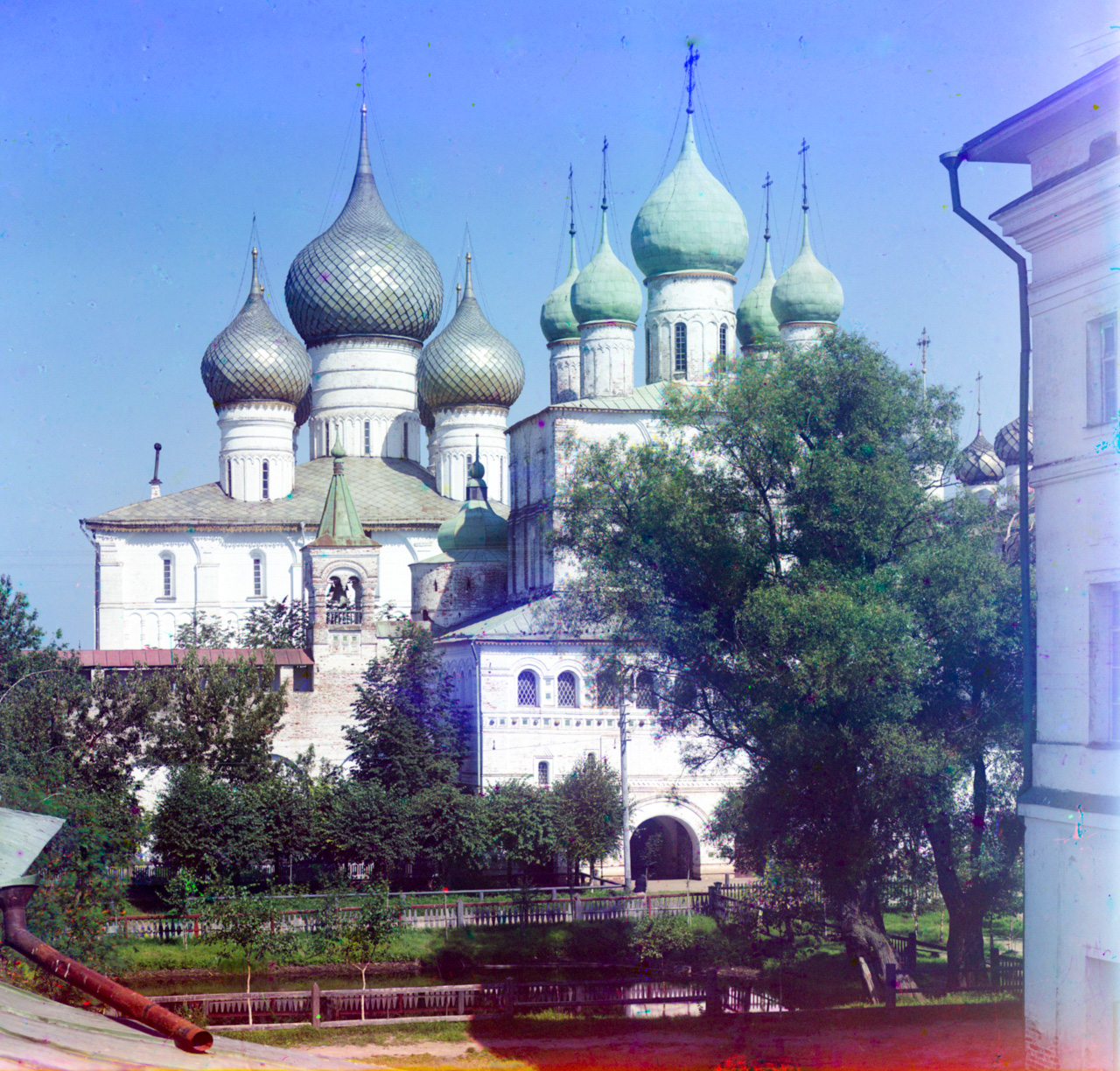 Rostov kremlin. Church of Resurrection (right), north wall, Dormition Cathedral. View north from Metropolitan's chambers. Summer 1911. / Photo: Sergei Prokudin-Gorsky