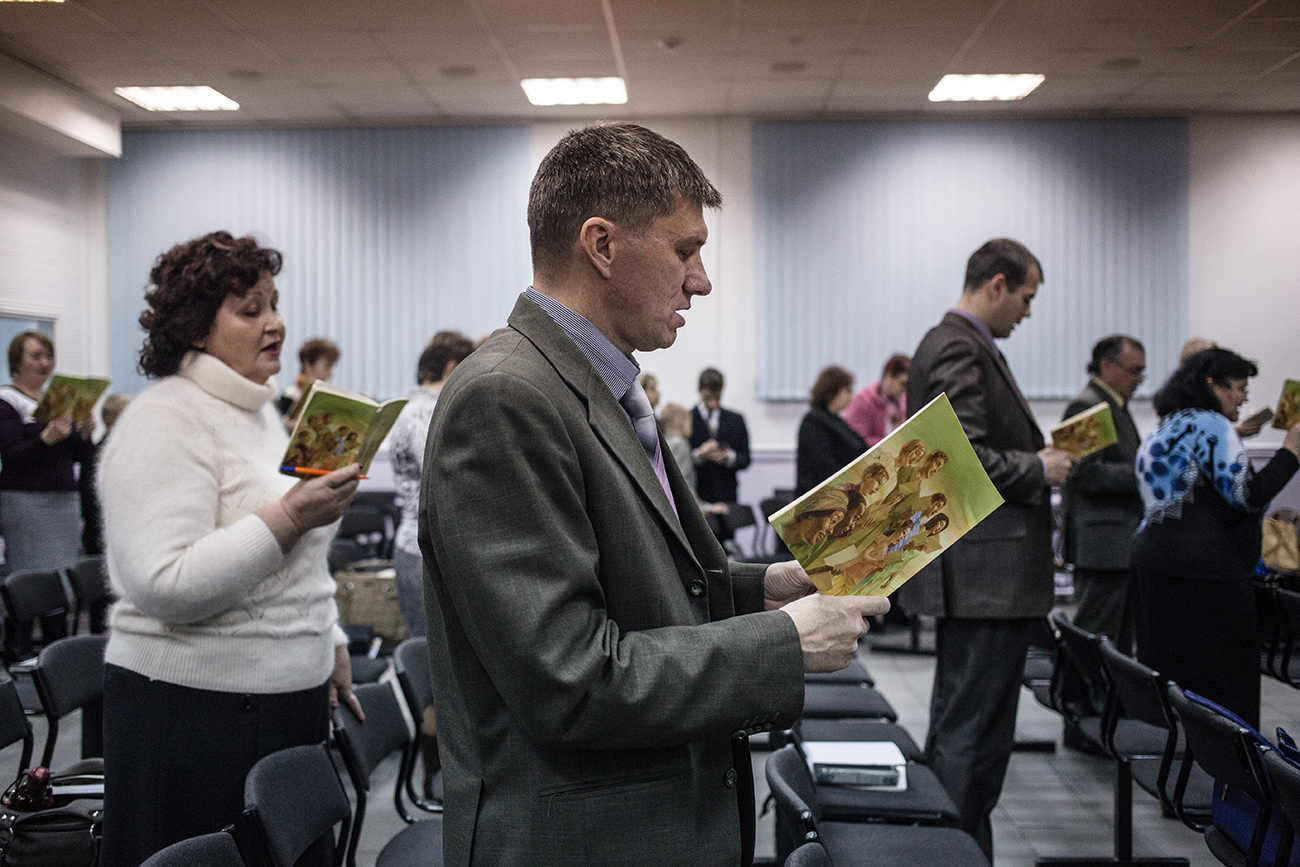 Members of Jehovah's Witnesses attend a church service.