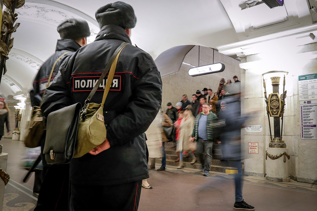 Policemen patrol at Pushkinskaya subway station in St.Petersburg, Russia, Friday, April 7, 2017. A bomb blast tore through a subway train under Russia's second-largest city on Monday, killing many people and wounding many others.