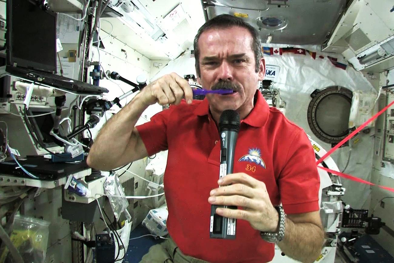 Chris Hadfield brushes his teeth in space.