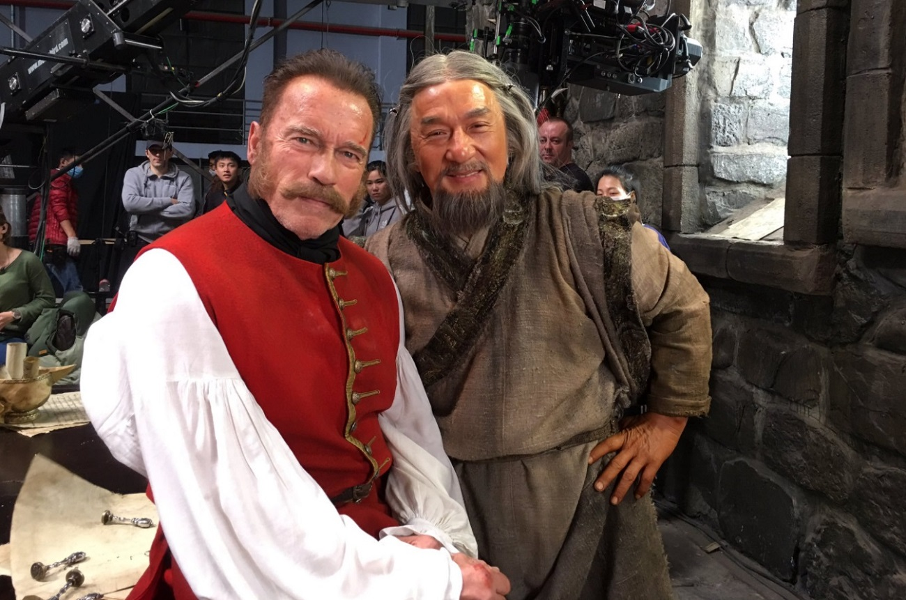 Arnold Schwarzenegger and Jackie Chan on the set of 'The Mystery of Dragon Seal: Journey to China'. Source: PLANET PHOTOS/Global Look Press