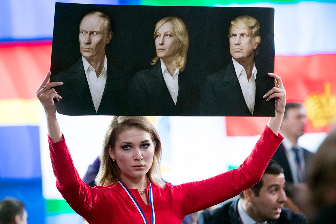 portraits of Russian President Vladimir Putin, left, France's far-right National Front president, Marine Le Pen, center, and President-elect Donald Trump