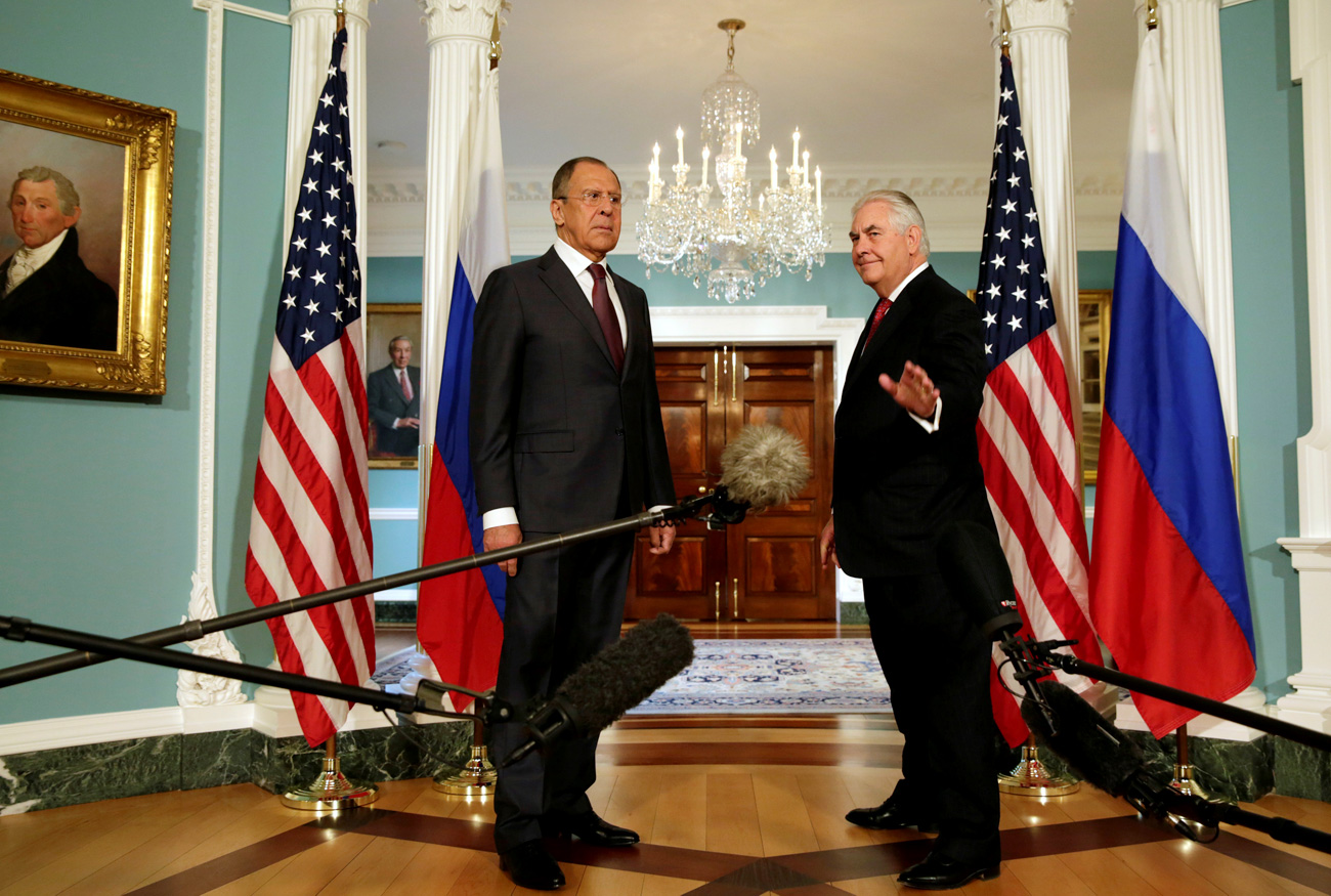 U.S. Secretary of State Rex Tillerson (R) waves to the media next to Russian Foreign Minister Sergey Lavrov before their meeting at the State Department in Washington, U.S., May 10, 2017