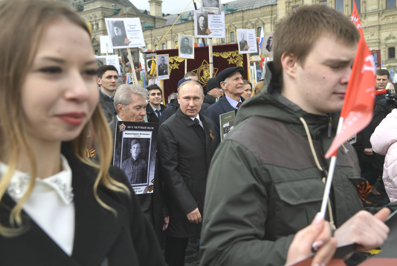 Russian President Vladimir Putin took part in the event in Moscow for the third year. The head of state appeared on Red Square with a picture of his father, a frontline soldier.