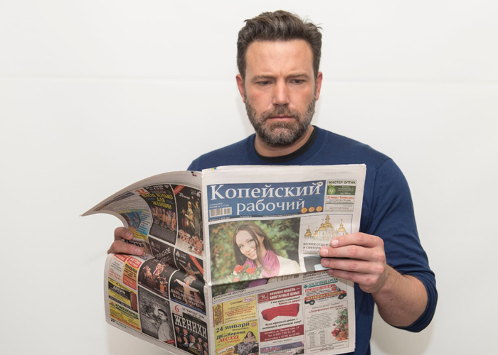 Ben Affleck is holding Kopeisky Rabochiy newspaper.