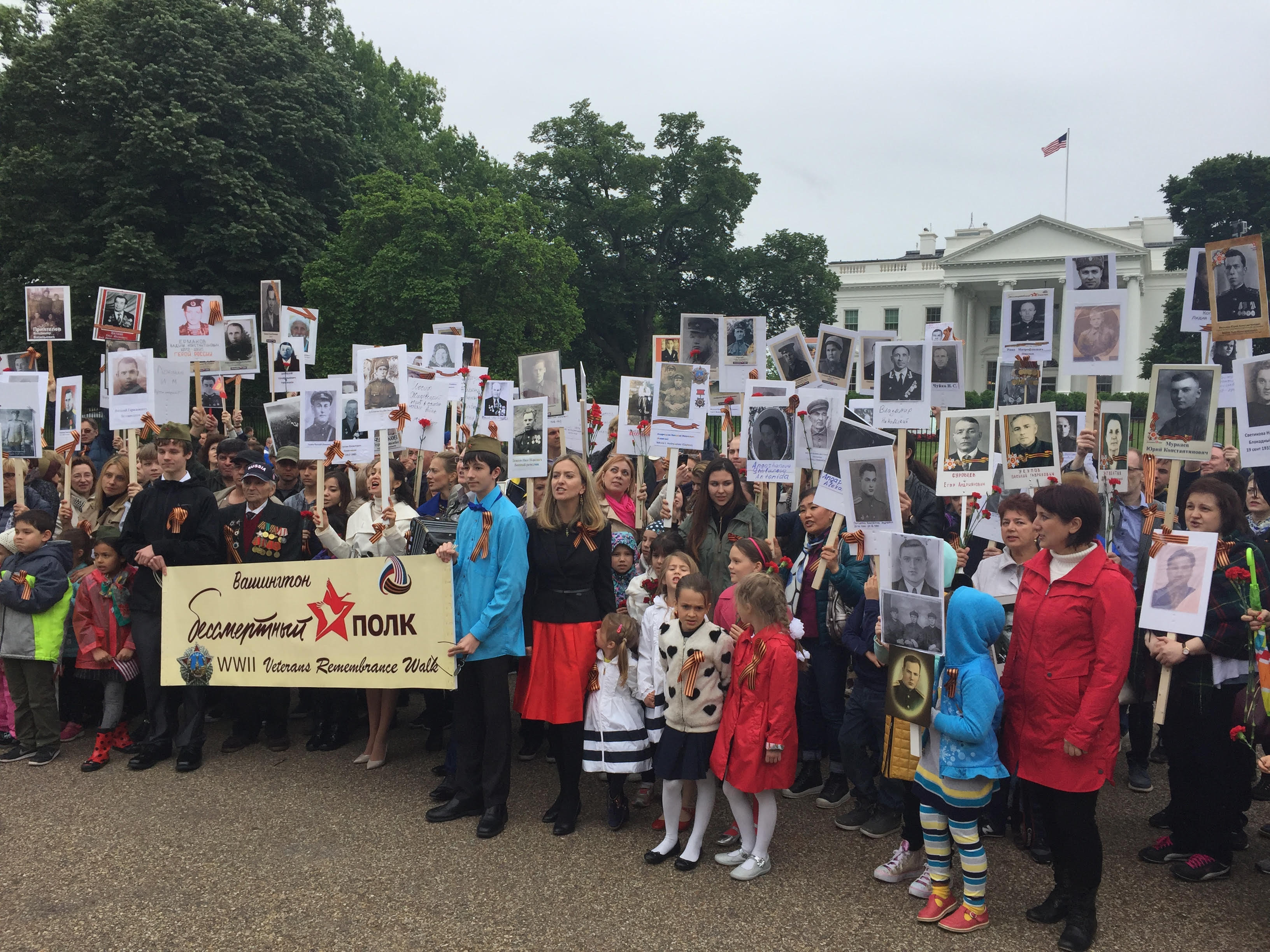 In Washington DC, the downtown area was closed for the Immortal regiment's march. The procession started at the White House and ended at the WWII memorial on the National Mall park. About 450 people turned up.