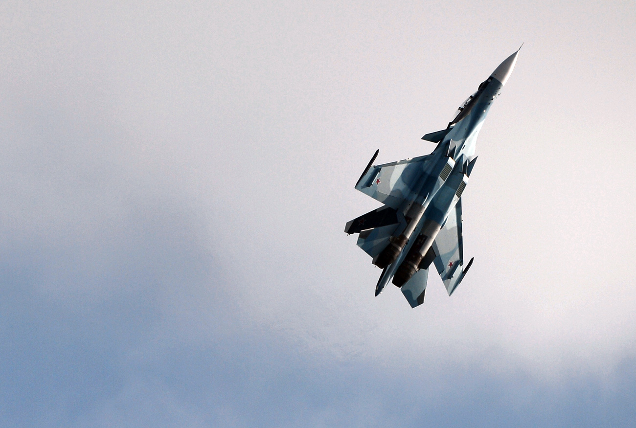Russian Su-30 'greeted' U.S. aircraft over Black Sea.