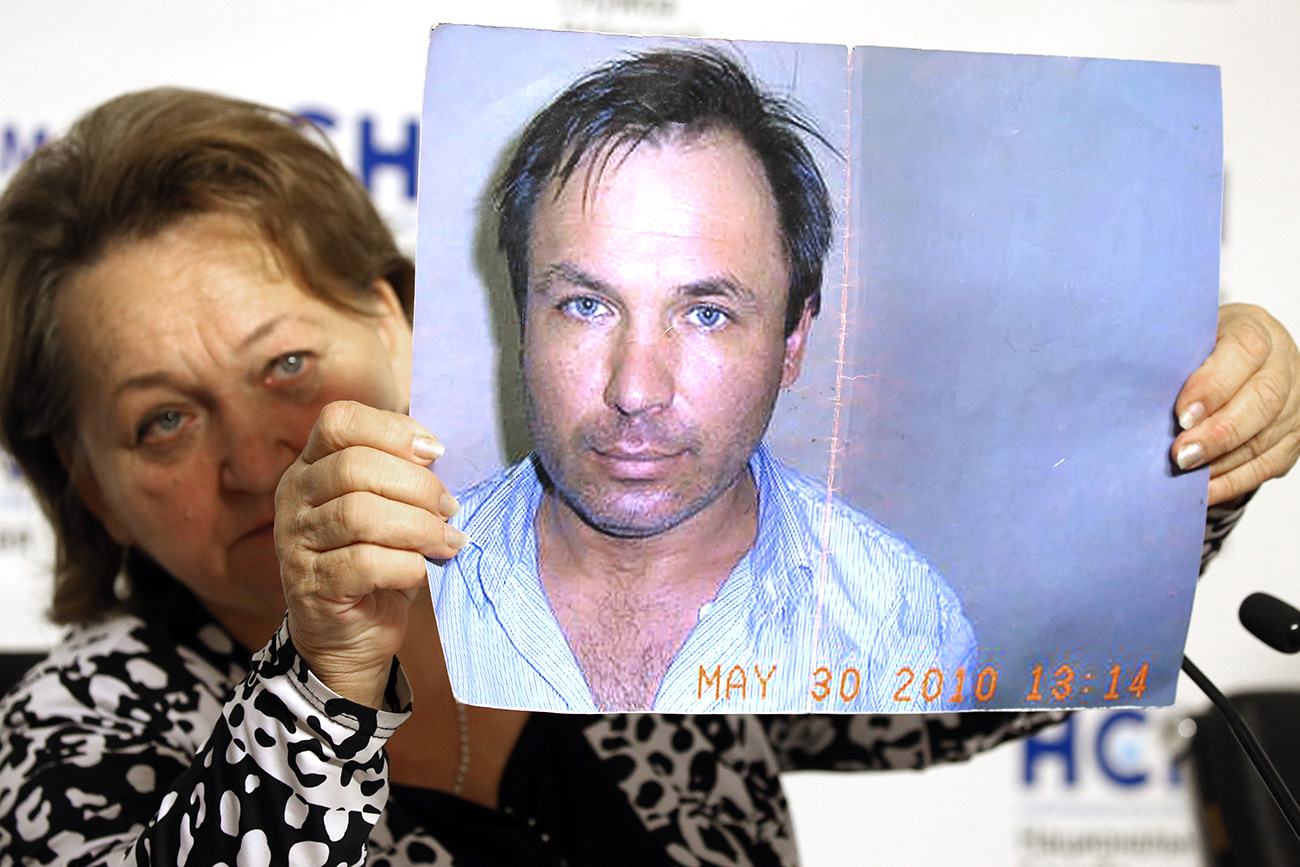 Lyubov Yaroshenko, the mother of Russian pilot Konstantin Yaroshenko, holds a photograph of her son during a press conference. Konstantin Yaroshenko is serving a 20-year sentence for drug trafficking in Fort Dix, a U.S. federal prison in New Jersey.