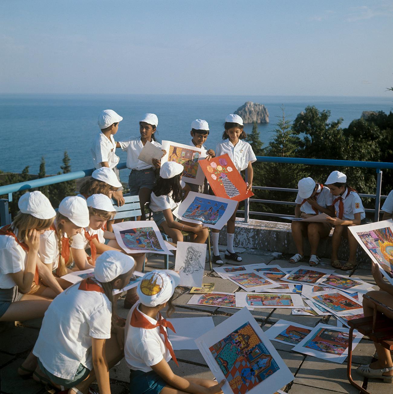 "For schoolchildren, having Pioneer status was a matter of immense pride. Photo: The All-Union Pioneer Camp ""Artek"" in Crimea. Young painters preparing for an arts festival.1975. Source: Runov/RIA Novosti"