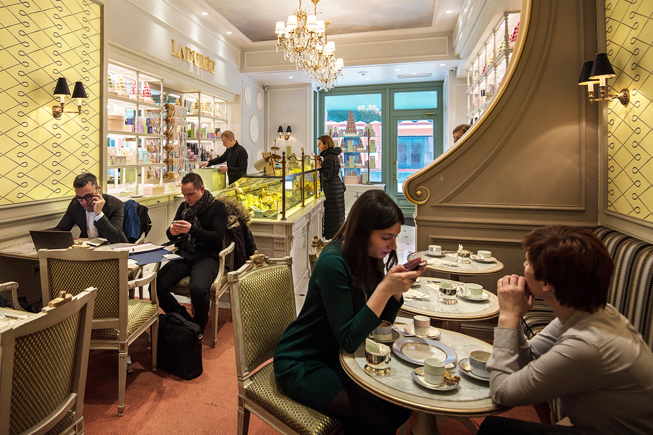Customers in a bakery of the French chain Laduree in Moscow.