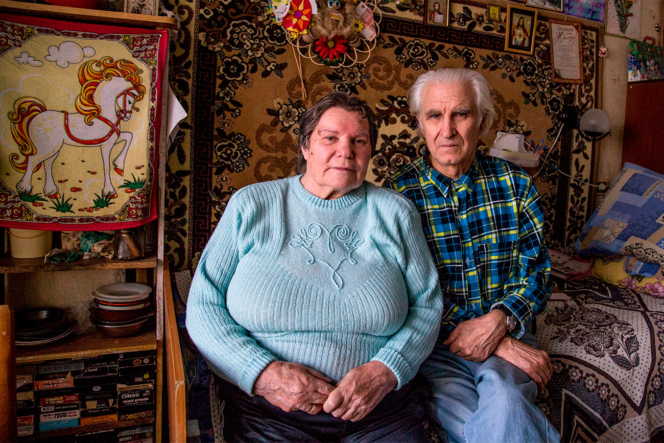 Ekaterina Krivosheeva (80) and Ivan Petrov also met at Vishenki. Ekaterina jokes that she won her husband in a card game. In summer pensioners who live in the home for elderly people love playing card games outdoors. A lot of people make acquaintances there. One day during a card game Ekaterina noticed that Ivan was letting her win on purpose, and that is how their relationship started. After a few months of dating Ivan offered Ekaterina to move in together, but she was in doubt. Ekaterina is physically disabled and did not want to become a burden for Ivan. However, that did not put him off, and soon they started living together. Though Ekaterina has serious problems with her health, she is very optimistic. She sings the leading part in a song ensemble. Ivan supports his woman and takes care of her.