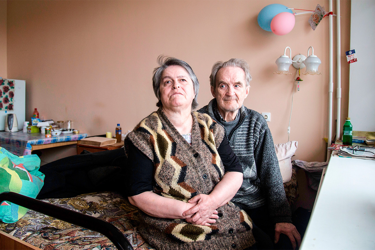 Natalia Alekseeva (66) and Anatoly Alekseev (76) met at a state boarding house for the retired and disabled. This is where they are now living. Natalia has been blind from the age of 3, and Anatoly is visually impaired. They both were brought to the boarding house against their will: Natalia's sister had refused to take care of her disabled relative, and Anatoly had been left homeless, plus his son refused to give him money. They used to like to walk together in the nearest park, but now as Natalia is barely able to walk they almost never leave the territory of the boarding house. // Sometimes this judgement is what stops old people from having a new family, despite sociologists saying that relations between couples (including transgender partnerships) cannot be substituted by relations with friends at any stage of life.