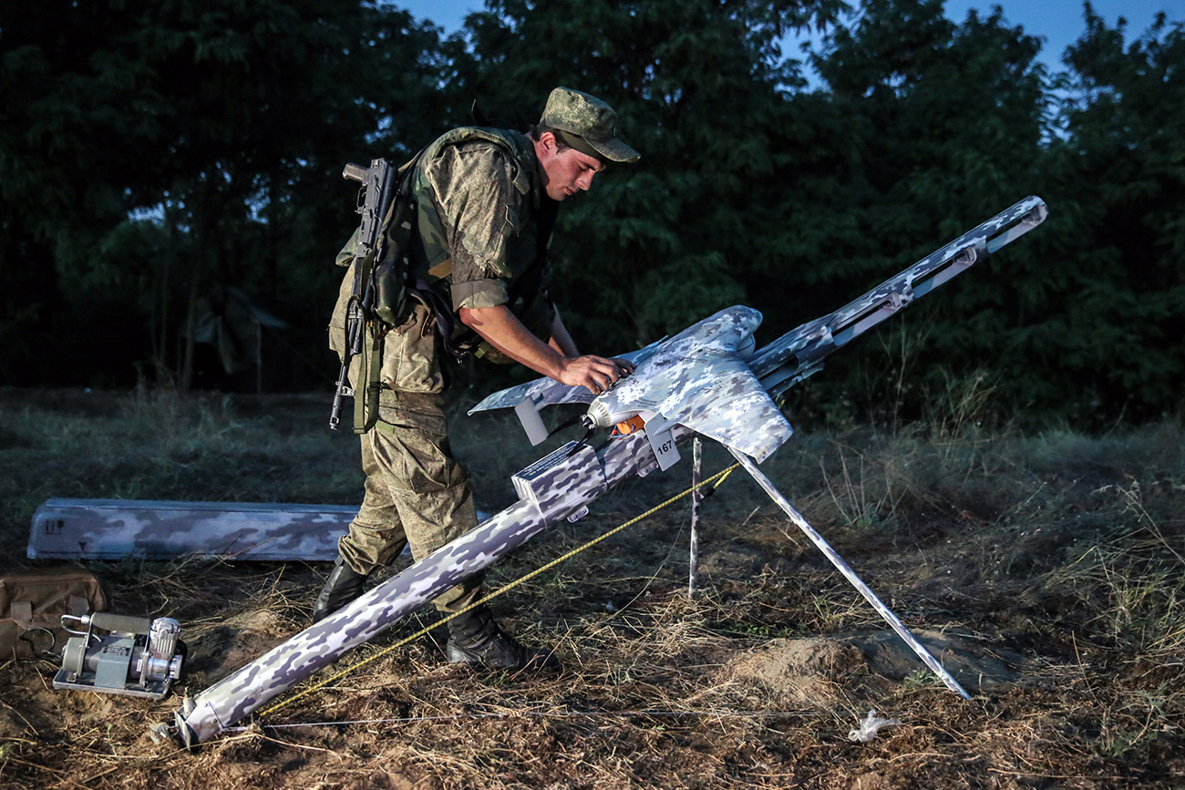 """Software has been developed to allow a group of six aerial vehicles to be controlled simultaneously."" Photo: An air drone being launched during tactical exercises held by motorized infantry units of Russia's Southern Military District."