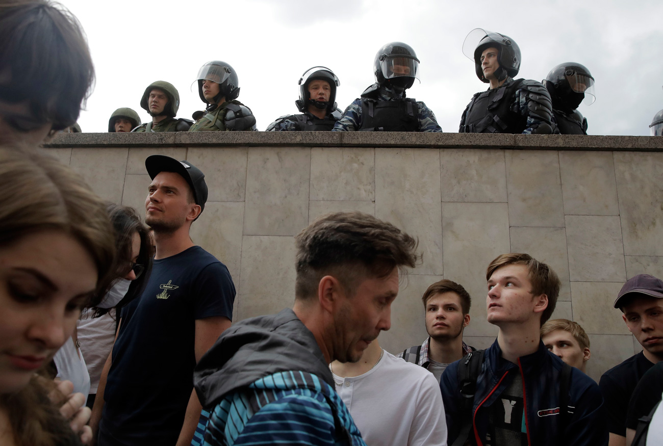 Police watch over a demonstration in downtown Moscow, June 12, 2017. / AP