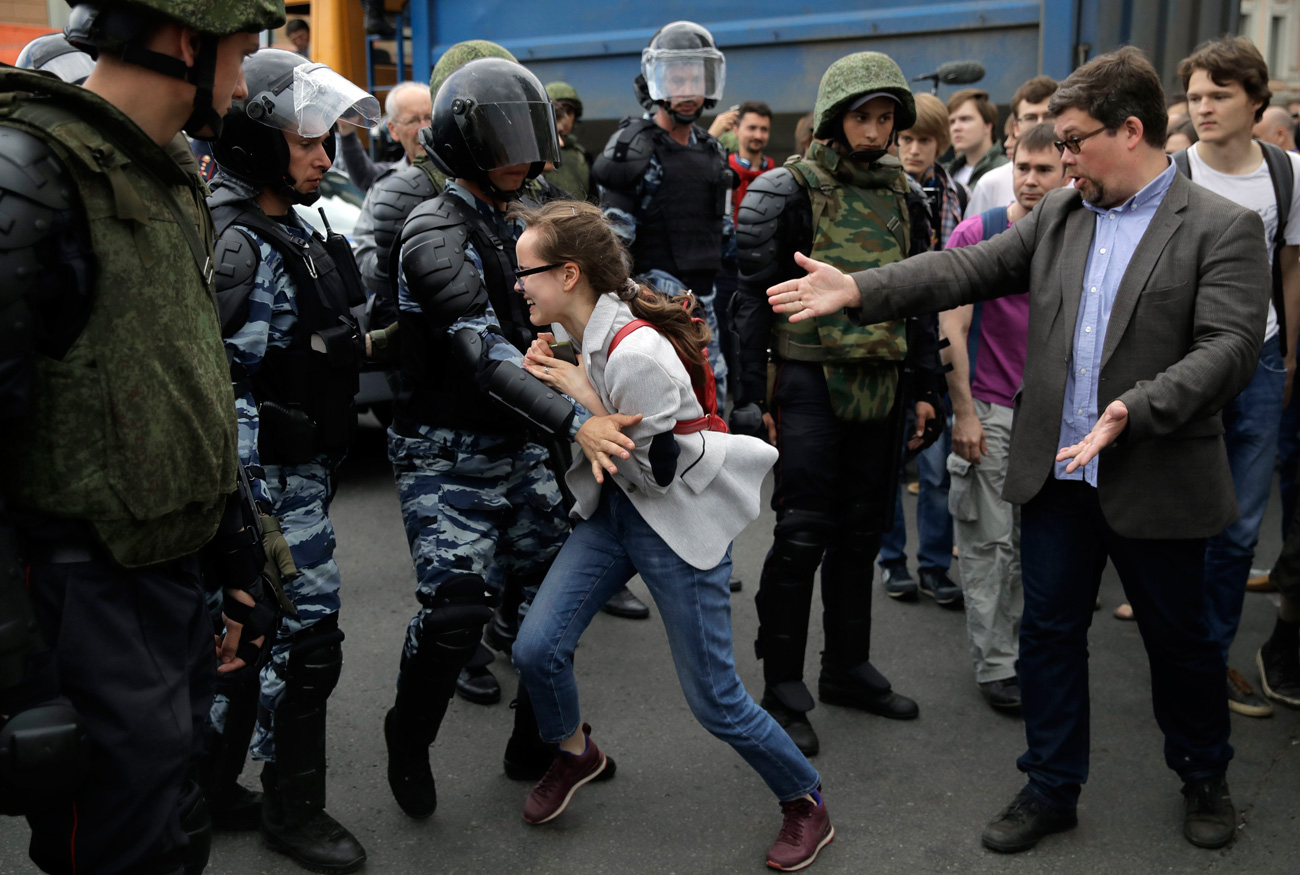 A young girl reacts after her friend was detained by police during a demonstration in downtown Moscow, June 12, 2017.