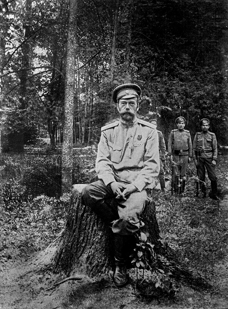 "Tsar being guarded in Alexander Palace garden. ""One day four soldiers with rifles followed me, I took advantage of this and without saying a word, went further in the park. From then I started daily long walks in park and chopped dry trees in the afternoon,"" Nicolas wrote in a letter to his sister Ksenia."