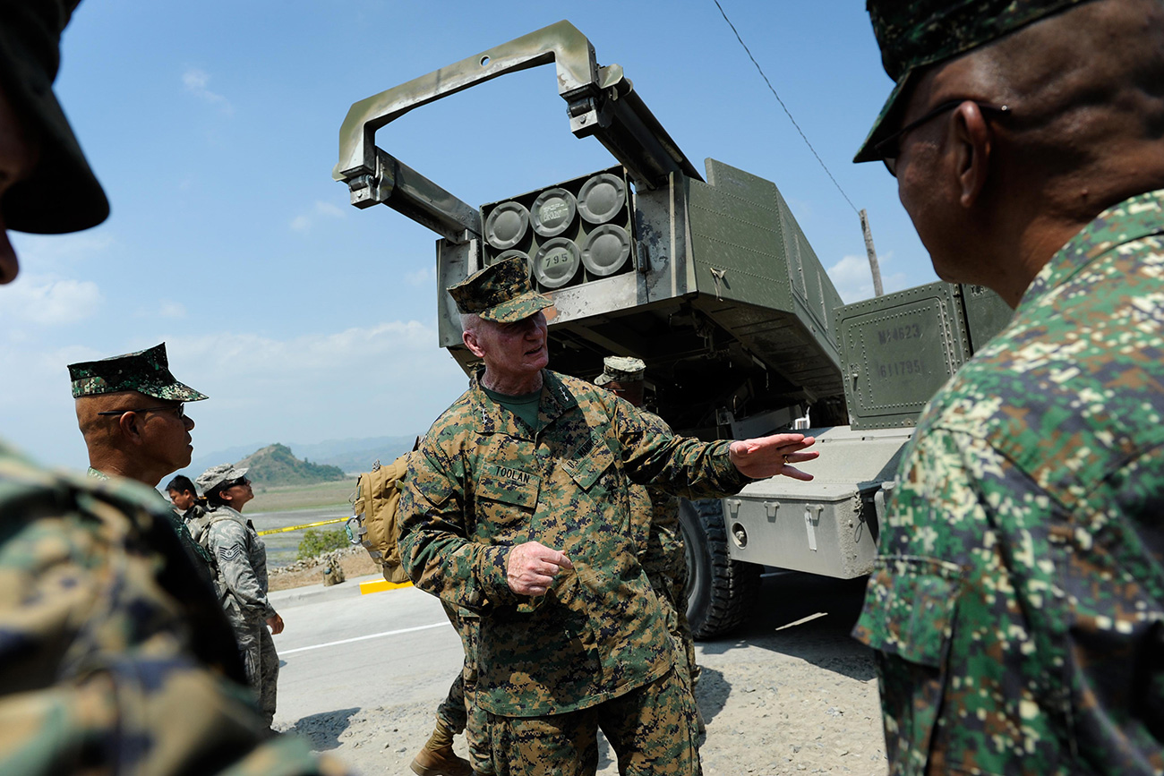 CROW VALLEY, PHILIPPINES - APRIL 14: U.S. Marines Expeditionary commander in the Pacific Lieutenant General John Toolan (C) stands behind a High Mobility Artillery Rocket System (HIMARs) during joint military exercises on April 14, 2016
