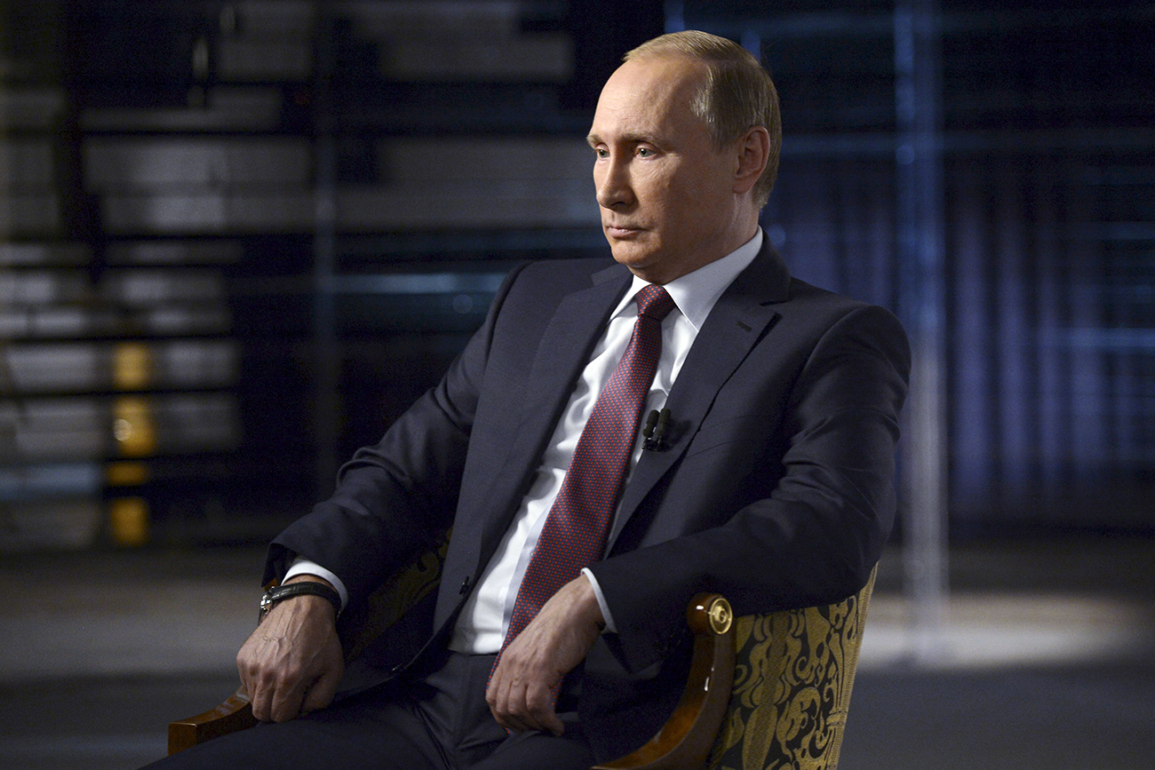 FILE PHOTO. Russian President Vladimir Putin gives an interview