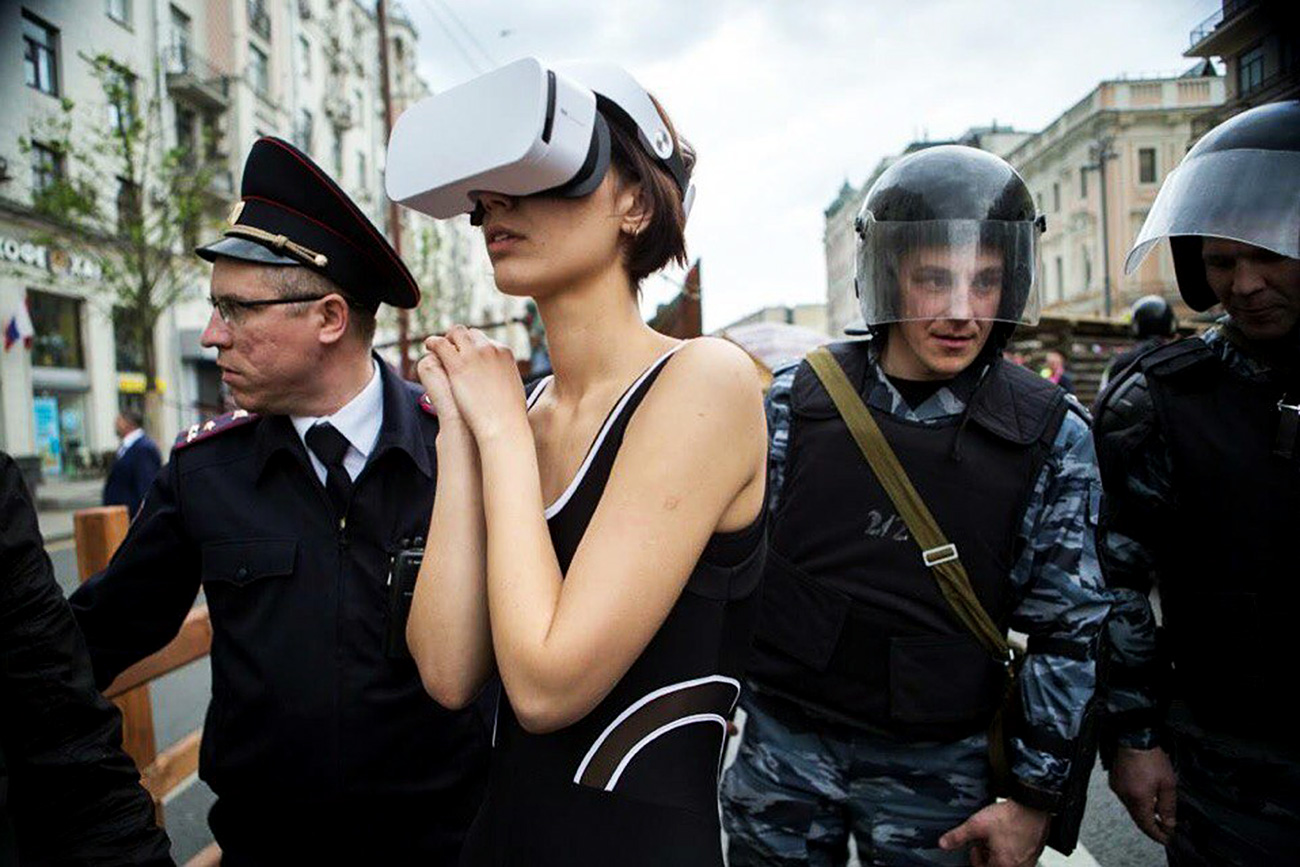 Katrin Nenasheva being detained by police.