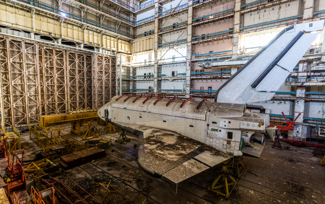 "The hangar that houses the Buran shuttles is about 30 kilometers (18.6 miles) away from the former missile launch facility. It is in the territory of the cosmodrome and has decent and used roads, and a security system with patrols. ""In the early hours of the morning we met a group of Russians inside the hangar,"" Raskalov says. ""They had the same goal- that is to take impressive pictures. But there was also a patrolman in the hangar. I was able to hide, but the members of my group were not as lucky. Later that night they caught me too."""