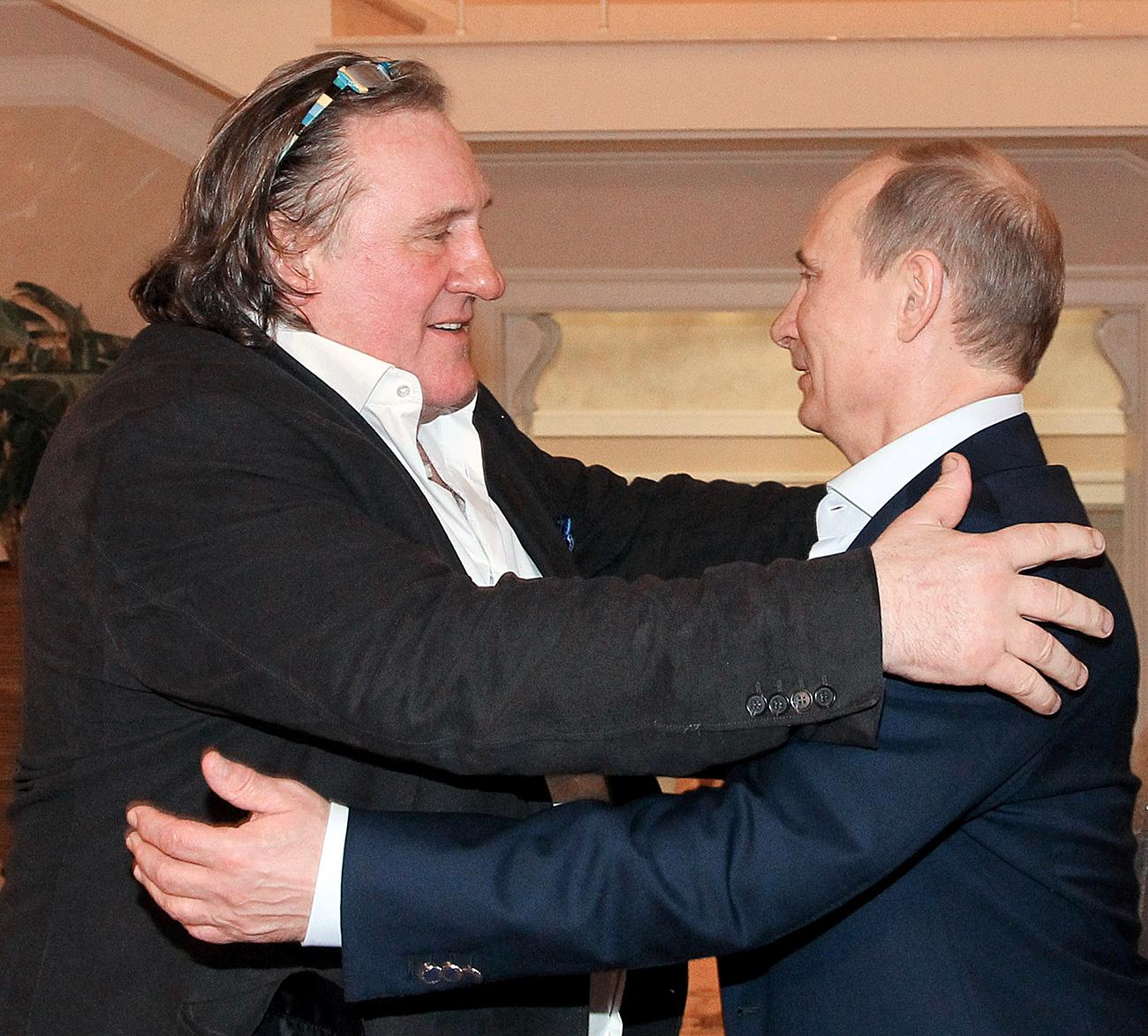 President Vladimir Putin, right, and French actor Gerard Depardieu, who has been handed his new Russian passport, meet in Sochi. Source: Michael Klimentyev/RIA Novosti
