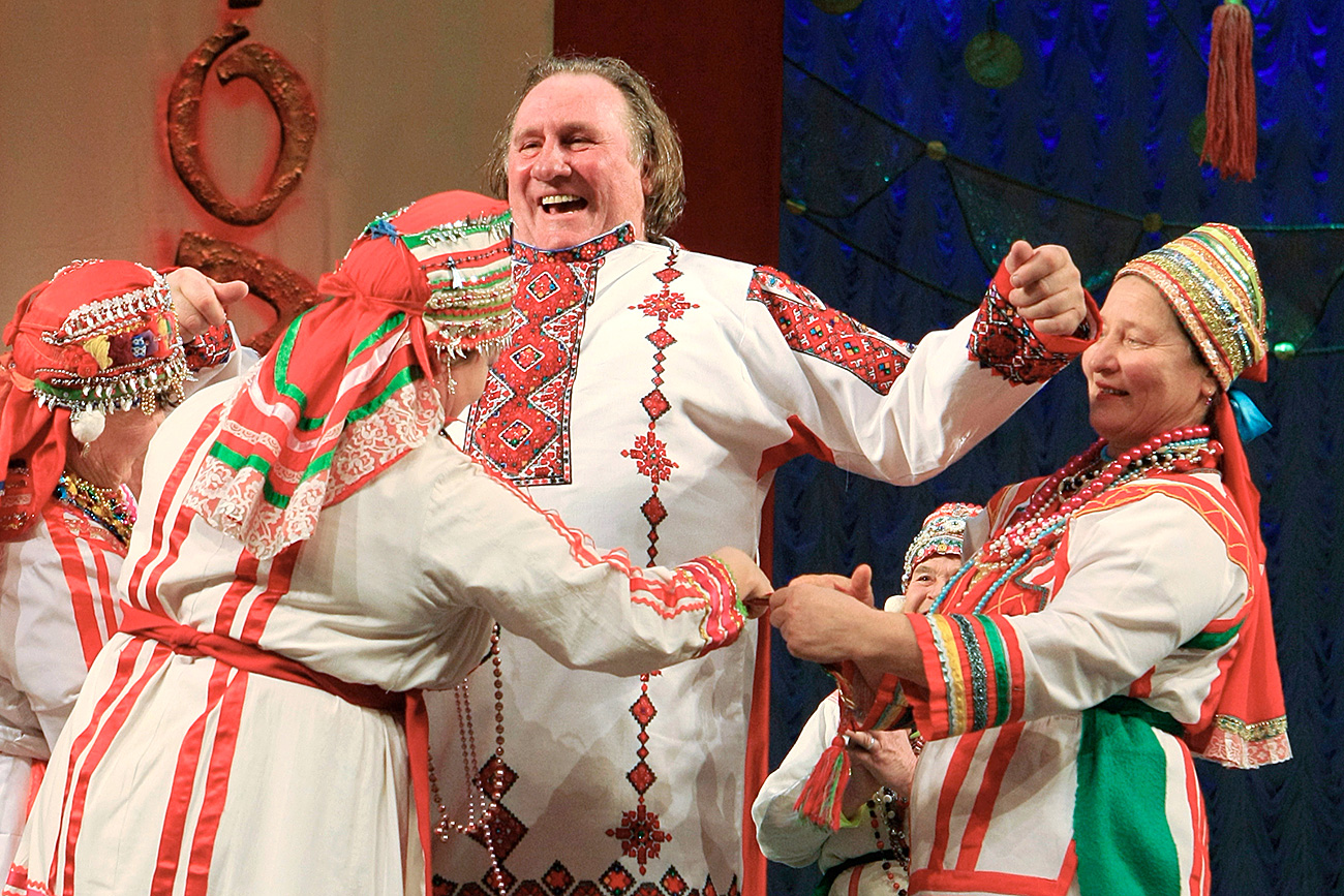 French actor Gerard Depardieu, who was granted Russian citizenship, puts on a Mordovian national shirt on stage in the Theatre of Opera and Ballet in Saransk.