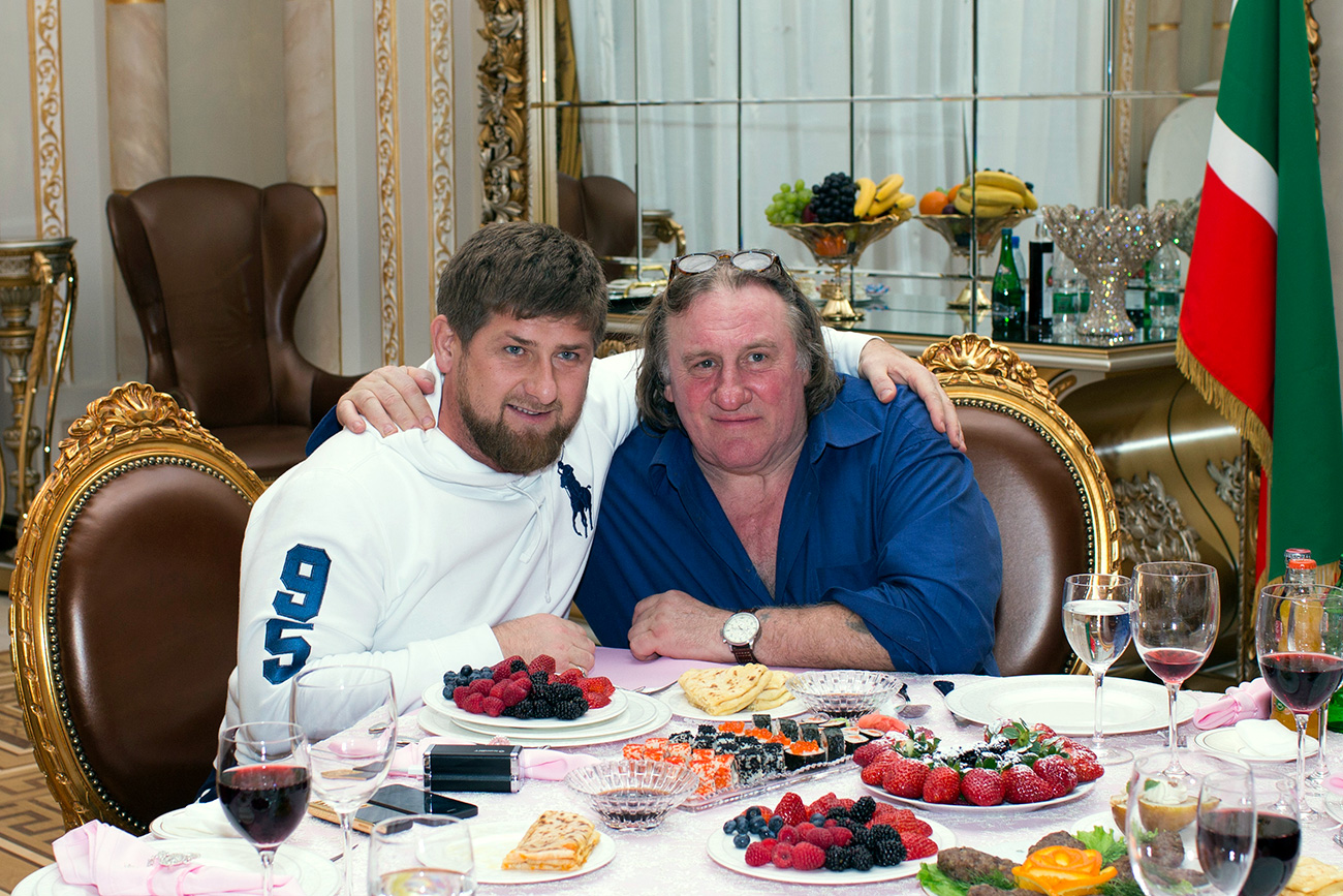 Actor Gerard Depardieu (R) poses for a picture with Chechen President Ramzan Kadyrov during a meeting at the presidential residence as he visits the capital of the Chechen Republic, Grozny, in Febuary 2013. Source: Reuters