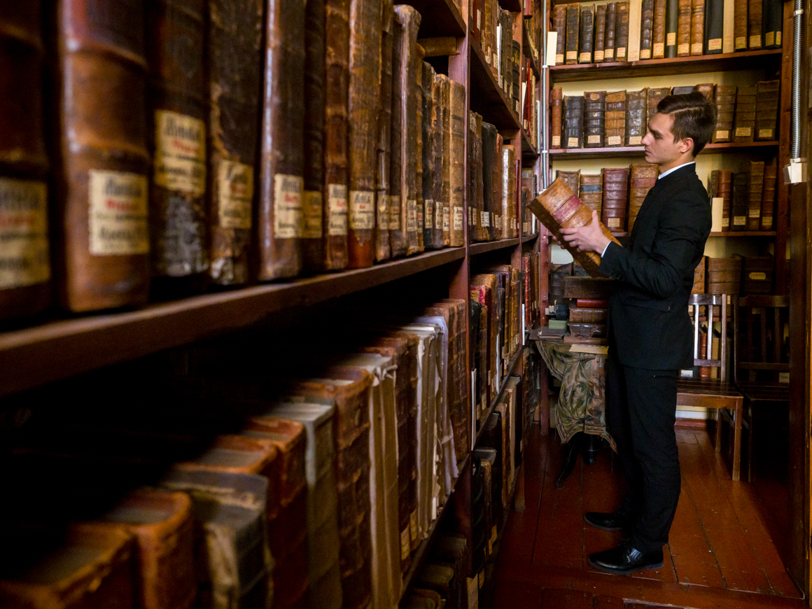 Student Vlad Grigorovich pictured in the library of the St. Petersburg Orthodox Theological Academy.