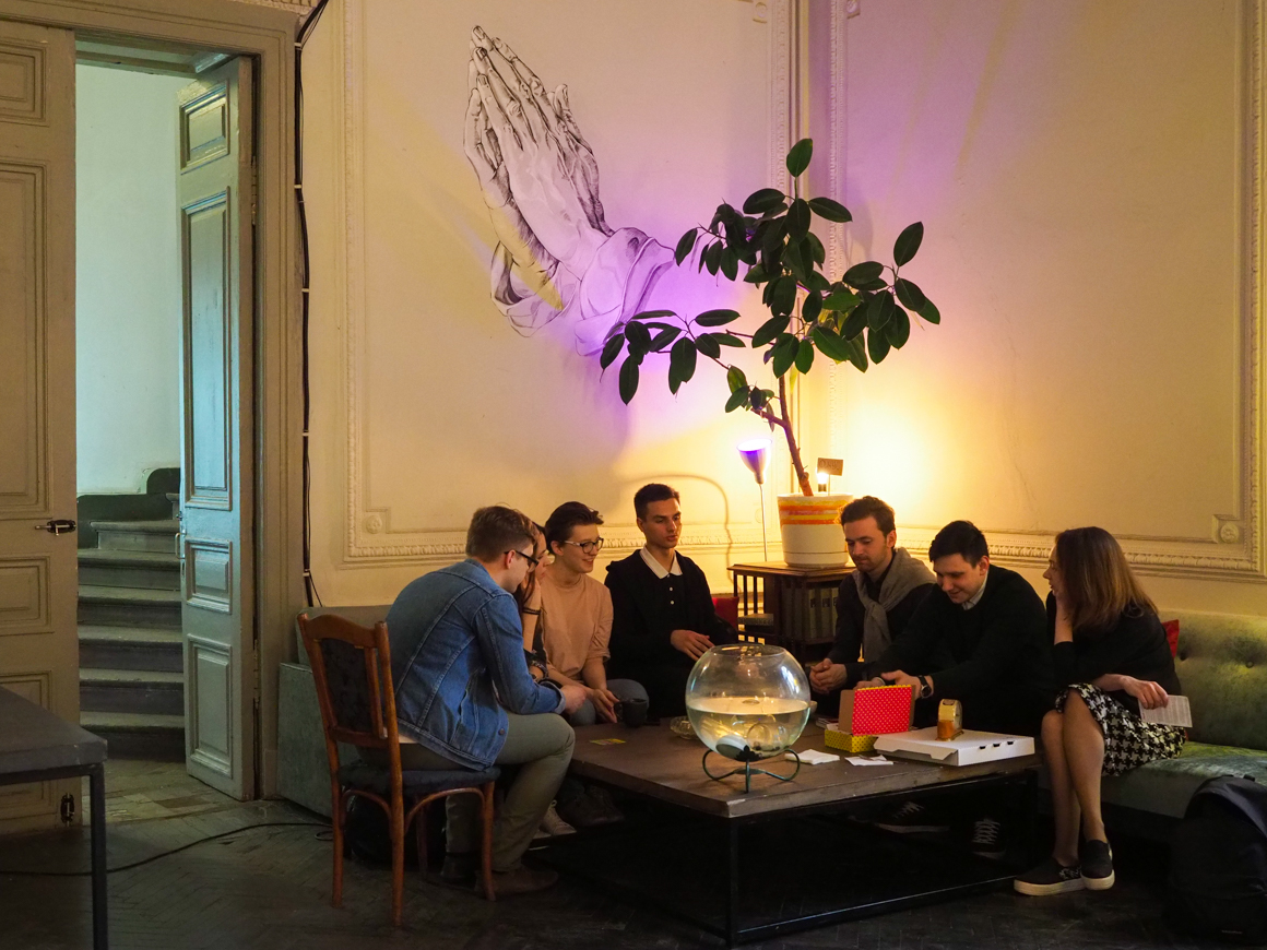 Vlad with friends playing table games in an anti-cafe. Source: Ruslan Shamukov
