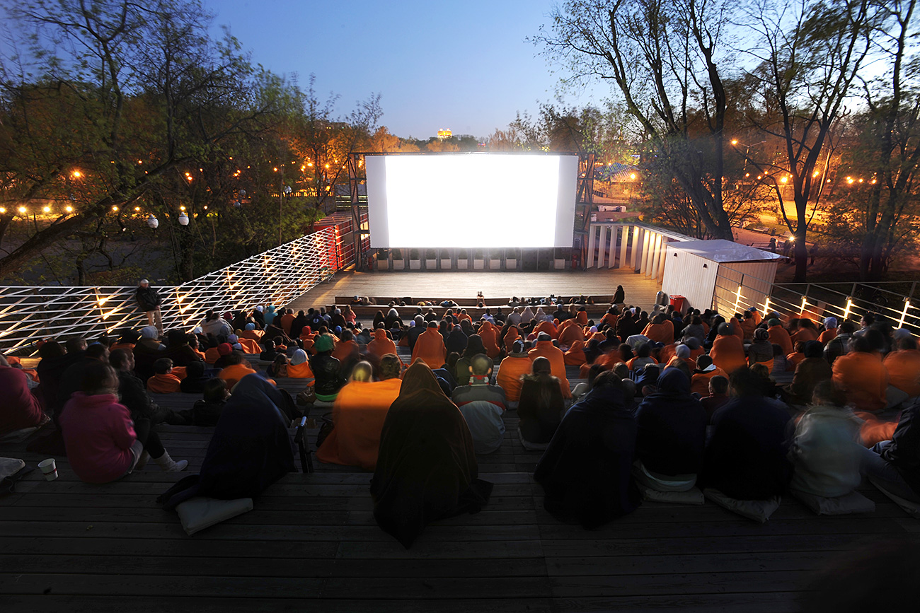 People watching a movie in a Pioner 24-hour open-air cinema in Gorky Park.