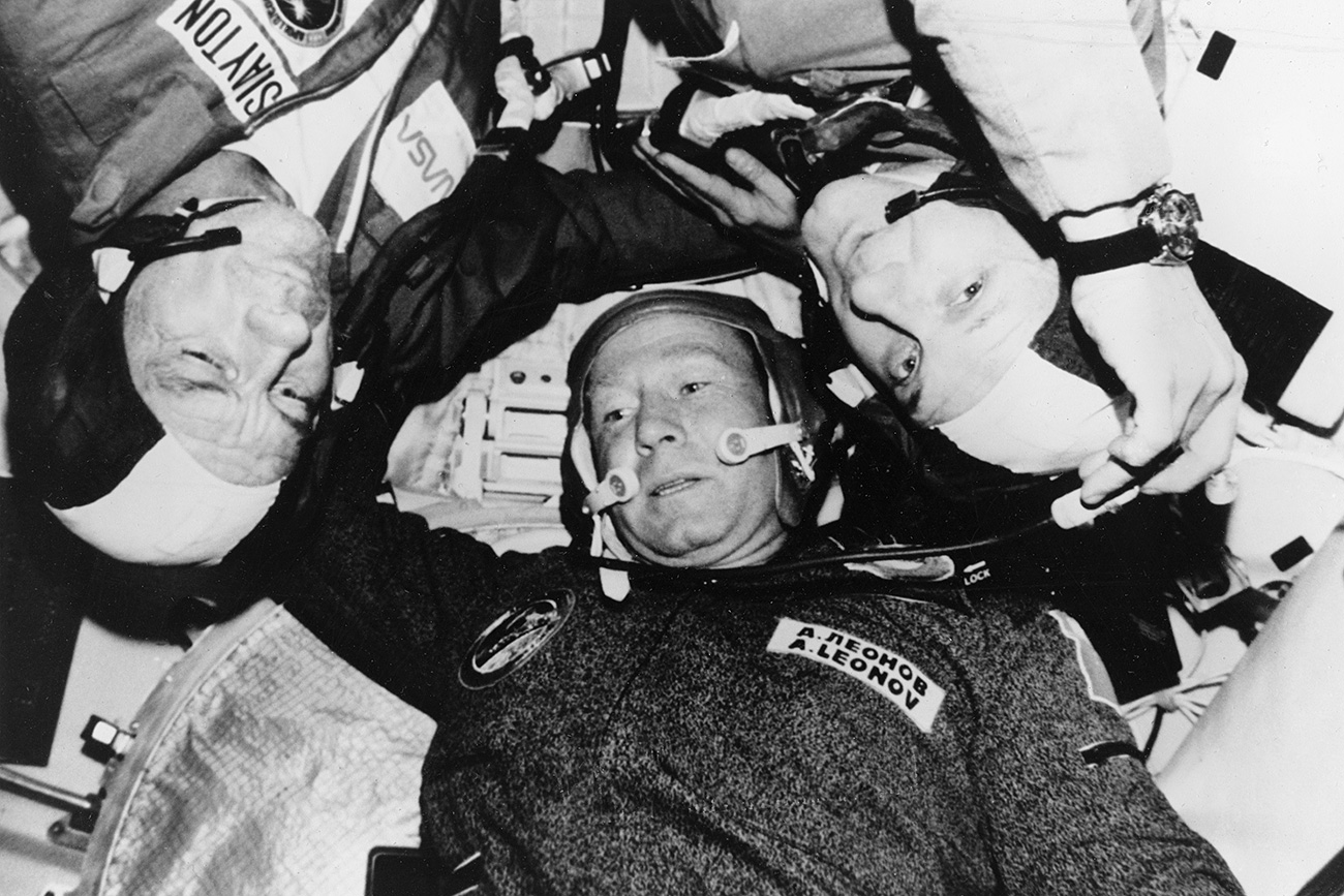 Astronaut Donald Slayton, cosmonaut Aleksey Leonov and astronaut Thomas Stafford are photographed in the Soviet Soyuz Orbital Module during the Apollo-Soyuz test project docking in Earth orbit mission, July 1975.